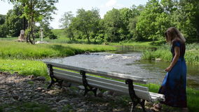 Park bench river stock footage