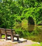 Park Bench on River at Horton Slough. River view at Horton Slough with park bench Royalty Free Stock Photo