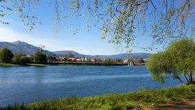 River side view in Ponte de Lima. Park bench in river side view in nature landscape, Ponte de Lima, Portugal stock video footage