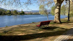 River side view in Ponte de Lima. Park bench in river side view in nature landscape, Ponte de Lima, Portugal stock video