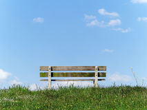 Park bench on a riverside in the Netherlands. Park bench with a view on the river. The Netherlands, Zwolle Royalty Free Stock Photography