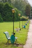 Park bench in row, selective focus on first Stock Image