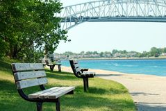 Park bench Sarnia ontario blue water bridge Stock Image