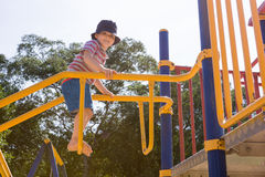 Young boy playing on climbing frame. Young boy playing in playground Royalty Free Stock Images
