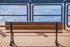 Park bench at a seaport Stock Photography