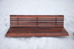 Park bench in the snow Stock Image