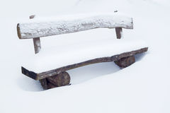 Park bench in the snow Royalty Free Stock Photo
