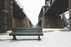 Park bench in snow Stock Images