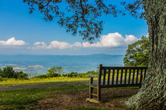 Park Bench with Spectacular View. Park bench located on top of mountain range  overlooking the valley below.   Skyline Drive, VA in the Shenandoah National Park Royalty Free Stock Images