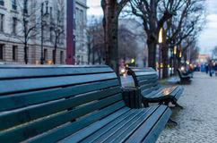 Park bench at street in the evening Stock Photo
