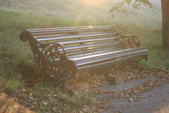 Park bench sun haze Stock Photography