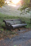 Park bench sun haze Stock Image