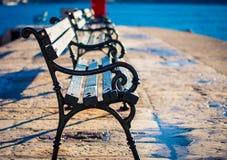 Park bench at sunrise stock image