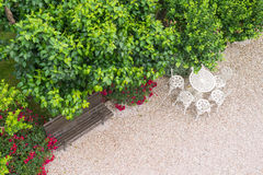 Park bench and table and chairs from above. Park trees and path with bench and table and chairs Royalty Free Stock Images