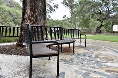 Park bench to rest on Royalty Free Stock Photo