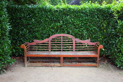 Park bench in topiary garden Royalty Free Stock Photos