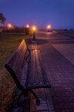 Park bench in Trois-Rivieres during a morning fog, Quebec. Stock Photo