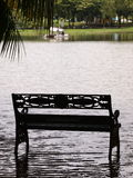Park bench under flood Royalty Free Stock Photography