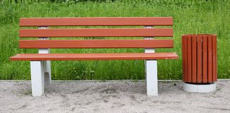 Park bench with an urn for rubbish stock photo