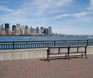 Park Bench and view of New York City skyline Stock Image