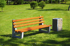 Park bench and waste bin Stock Images