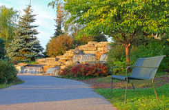 Park bench and waterfall Stock Photos