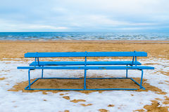 Park bench on a winter beach Royalty Free Stock Photography