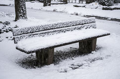 Park bench in winter Stock Image