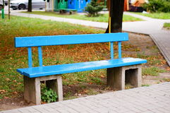 Park bench. Wooden park bench painted in blue royalty free stock photography