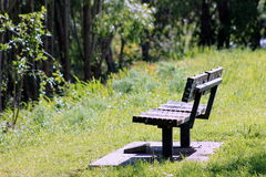 Park Bench. A wooden park bench provides somewhere to rest Royalty Free Stock Image