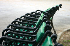 Park Benches. A row of park benches royalty free stock photo