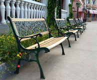 Park Benches. Black park benches along walkway royalty free stock photo