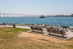 Park Benches at Embarcadero Park South in San Diego. California with the Coronado Bridge in the background stock photos