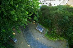 Park with benches, footpath and trees, summer. Park with benches, footpath and trees, view from above, summer, Spain royalty free stock photo