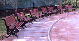 Park benches landscape. Ornamental benches in a garden landscape stock images