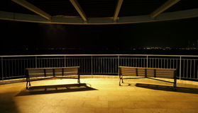 Park benches at night Stock Photo