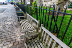 Park benches outside of the Tower of London in London, UK Royalty Free Stock Photos