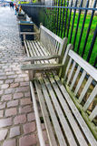 Park benches outside of the Tower of London in London, UK Royalty Free Stock Images