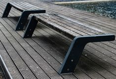 Minimalistic shot of park benches stock photos