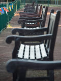Park benches. A row of benches in a park stock images