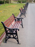 Park benches. Row of newly installed park benches in a park in north-west Englland Stock Photos