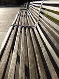 Park benches in the sun Royalty Free Stock Photo