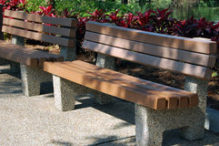 Park Benches. On a sunny afternoon in partial shade Royalty Free Stock Photos