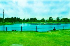 Park with Blue Lake on Summer. stock photo