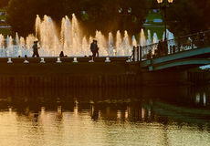 Park with bridge lake and fountains Royalty Free Stock Photography