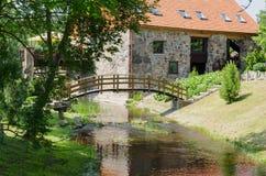 Park with bridge over stream ancient brick manor Stock Photos