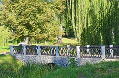 Park bridge at spring. Old park bridge, Alexandria, Belaya Tserkov, Ukraine Royalty Free Stock Photo