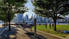 Park in Brooklyn with the view to new york city buildings stock photography