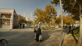 Park in the center of the Sufi city of Konya on the background of the mosque. KONYA / TURKEY - 11.20.2016 central streets of the ancient Turkish city stock video