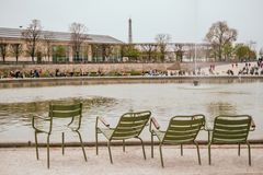 Park chairs in Tuileries Garden. Green park chairs near the fountain in the Tuileries Garden, Paris, France. Landmarks of Paris stock image